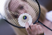 Picture of badminton player with racquet and shuttlecock